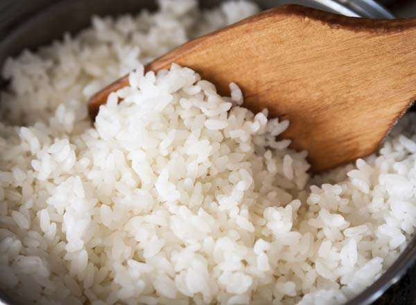 White rice in a metal pan.